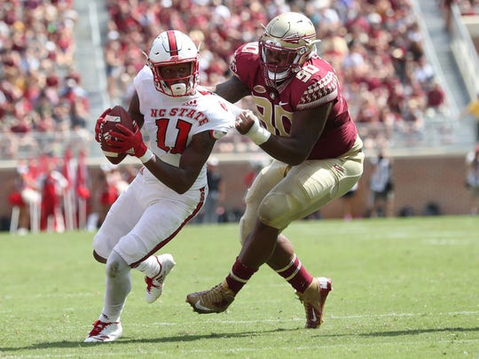 FSU's Demarcus Christmas drags down NC State's Jakobi
