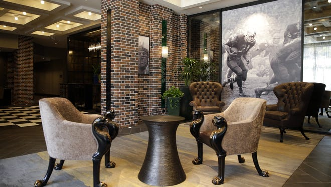 The lobby of Lodge Kohler in the Green Bay Packers' Titletown District features subtle touches of green and gold, and a large photo of Packers running back Jim Taylor. Sarah Kloepping/USA TODAY NETWORK-Wisconsin