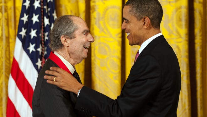 President Barack Obama presents the National Humanities Medal to Novelist Philip Roth during a ceremony at the White House in 2011.