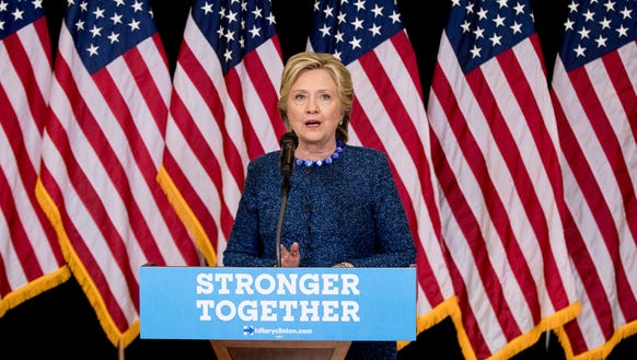 Hillary Clinton speaks at a news conference in Des