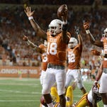 Oct 18, 2014; Austin, TX, USA; Texas Longhorns quarterback Tyrone Swoopes (18) reacts against the Iowa State Cyclones during the second half at Darrell K Royal-Texas Memorial Stadium. The Longhorns won 48-45. Mandatory Credit: Brendan Maloney-USA TODAY Sports