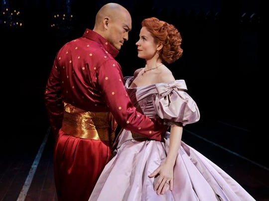 """In this image released by the Lincoln Center Theater, Kelli O'Hara, right, and Ken Watanabe appear during a performance of """"The King and I,"""" in New York. (AP Photo/Lincoln Center Theater, Paul Kolnik)"""