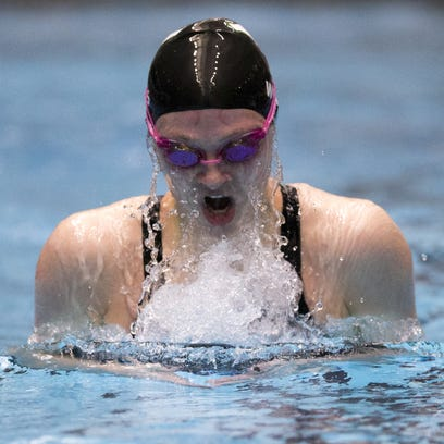 Yorktown's Emily Weiss swims the 100 breaststroke Saturday