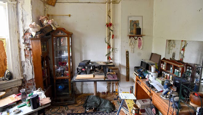 The apartment of Shawn Grate at 132 West 2nd St. is filled with woodworking tools, cigarette butts, stuffed animals and other personal effects.