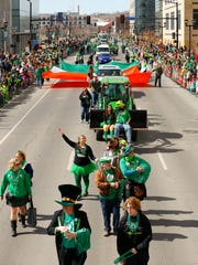The St. Patrick's day parade moves down Grand Ave. Tuesday, March 17, 2015.