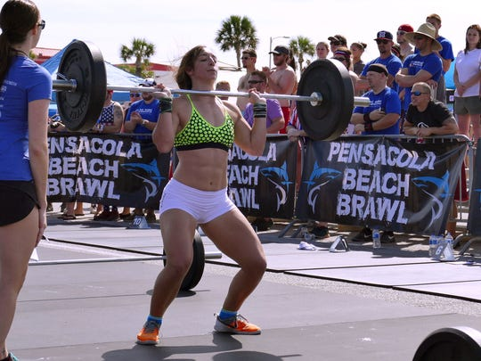 Alyssa Lafont lifts weights as she finishes up well in the lead of the second heat of the RX competition for women Saturday morning during the Pensacola Beach Brawl physical fitness event.