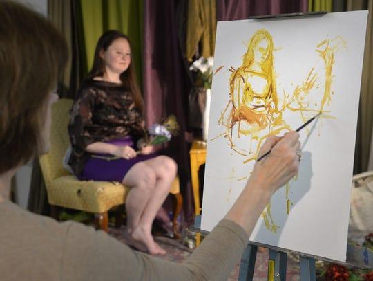 Artist Mickey Cunningham creates an oil sketch of a