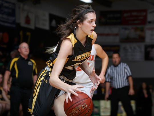 Enterprise's Aly Burke takes the ball to the basket