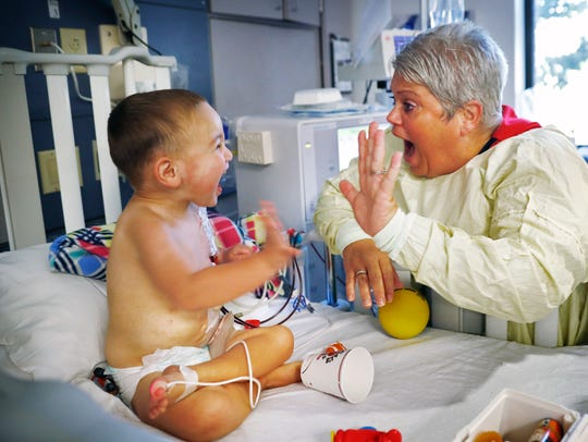 Three-year-old Henry Whitacre plays with Suzie Hedrick, RN, while he gets dialysis at Riley Outpatient Center, Thursday, July 12, 2018. He will receive a new kidney for his birthday on July 18. A long-lost friend of his mom's responded to a plea for a living donor on Facebook and will be the donor.