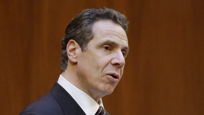 New York Governor Andrew Cuomo, shown speaking at New York University in New York, Monday, told reporters Wednesday schools could plan on a 1.7 percent budget increase.