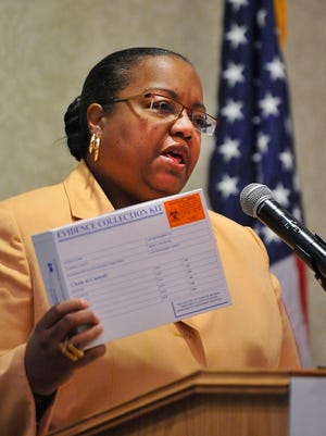 Wayne County Prosecutor Kim Worthy holds a rape kit while announcing the Enough SAID campaign to raise funds to process untested rape kits at a news conference Tuesday in Detroit.