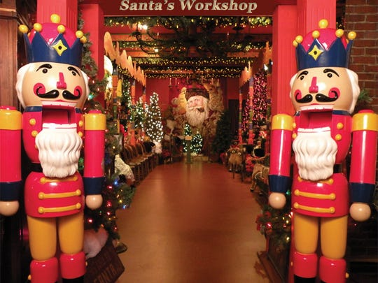 Life-size nutcrackers flank the doorway to Santa's workshop.
