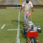 Kenneth Mallet, Opelousas Parks and Recreation employee, puts down the final stripes on the football field Wednesday at Donald Gardner Stadium signaling the start of the prep football season in Opelousas and St. Landry Parish. The season begins tonight with the Opelousas Kiwanis Club John Bradley Memorial Football Jamboree. More jamboree action continues Friday with the St. Landry Parish Football Jamboree.