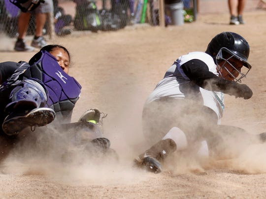 Kirtland Central catcher Mariah Bileen stops Navajo Prep's Taylor Yazzie from scoring during Friday's game at the Ricketts Park softball fields in Farmington.