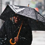 """Kerry Smith had a broken umbrella try to keep him dry as snow fell Wednesday afternoon in downtown Louisville. """"It's cold,"""" he said as he walked down on Fourth Street.  By Matt Stone, The Courier-Journal March 4, 2015"""