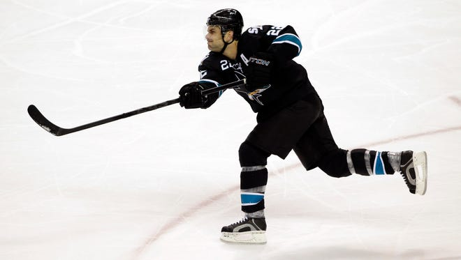 The Sharks' Dan Boyle shoots against the Oilers in January. The Rangers agreed to terms with Boyle on Tuesday on a $9 million, two-year contract.