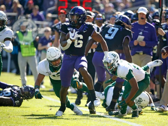 TCU running back Darius Anderson (6) carries the ball against Baylor during the first half of an NCAA college football game, Saturday, Nov. 9, 2019, in Fort Worth, Texas. (AP Photo/Ron Jenkins)