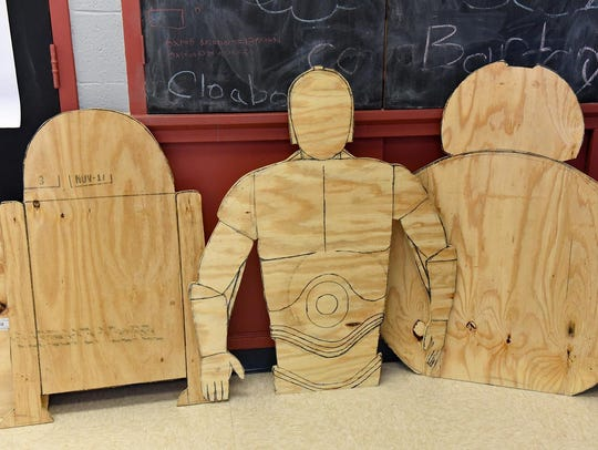 Star War plywood figures that students cut are on display