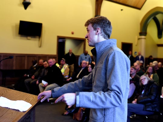 MSU student Sam Berndt voices his opposition to the proposed $500 million natural gas power plant during a commissioners meeting at the Board of Water and Light REO Town Depot facility on Tuesday, March 27, 2018, in Lansing.