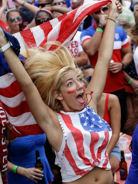 Nikki Madeira cheers as the United States blocks a shot as she watches a World Cup soccer match between the United States and Germany, Thursday, June 26, 2014, in Orlando, Fla. (AP Photo/John Raoux)