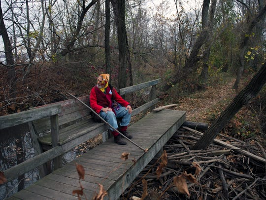 Rocky Wilson of Camden takes a break from hiking along the Delaware River Friday in Cinnaminson.