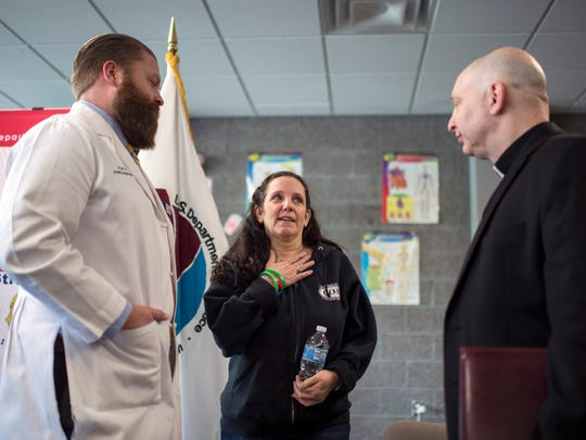 Charlene Maycott, center, speaks with Dr. James Baird,