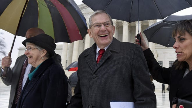APThe Rev. Clyde Reed, pastor of the Good News Presbyterian Church in Gilbert, smiles as he leaves the U.S. Supreme Court on Monday with his wife, Ann (left). Good News Community Church Pastor Clyde Reed, center, smiles as he leaves the Supreme Court in Washington, Monday, Jan. 12, 2015, with his wife Ann, left. The Supreme Court appears likely to side with a small church in its fight with a Phoenix suburb over limits on roadside signs directing people to Sunday services.