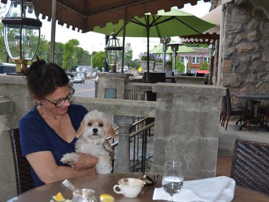 A patron and her dog dining at The Bernards Inn.