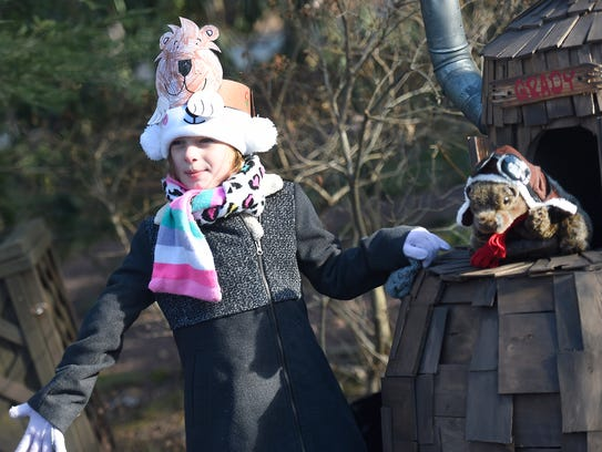 Sage Henery, 6, poses with Gretna Grady, Mt. Gretna's new groundhog weather prognosticator. Grady made his debut Saturday morning at the studio of Mt. Gretna artist Fred Swarr.