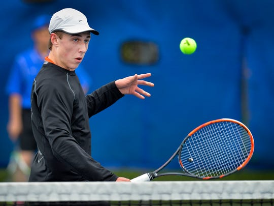 St. Cloud Tech No. 3 singles player junior Eric Inderieden watches his return fly over the net against Sartell freshman Yash Hindka Tuesday afternoon, April 26, at South Junior High School. Inderieden won 6-2, 6-1.