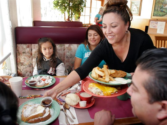 Carla Sanchez serves the Perez family at Country Harvest Restaurant in Newbury Park.