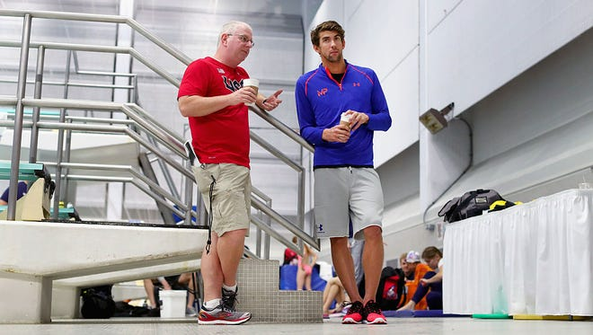 ASU's Bob Bowman, left, is going into his first Olympics as U.S. men's head coach and 18-time gold medalist Michael Phelps into his qualifying for his fifth Olympics, all with Bowman as his coach.