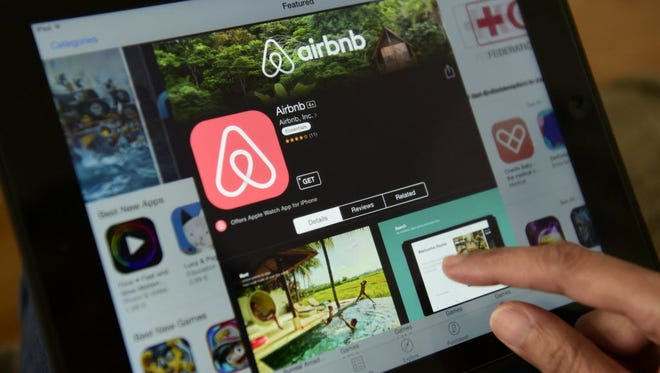 John MacDougall, AFP Airbnb on a tablet