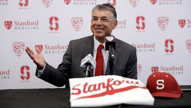 David Esquer fields questions during a press conference introducing him as the new head coach of the Stanford NCAA college baseball team Tuesday, June 20, 2017, in Stanford, Calif.