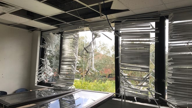 A classroom window is blown in by the wind from Hurricane Irma at Lehigh Senior High School.