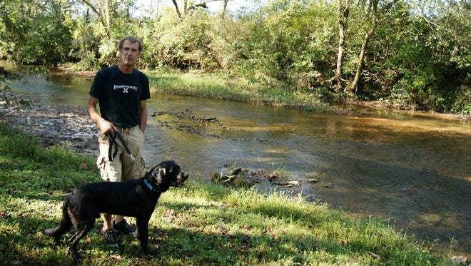 David J. Marks, with his blind black lab Buddy, is coordinating the Paws on the South Harpeth event, set for Saturday, October 7 in Fernvale.