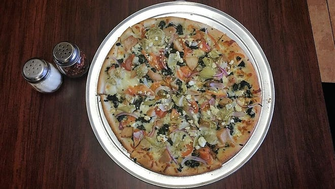Michelli's Favorite features grilled chicken, extra virgin olive oil, spinach, tomatoes, red onions, artichokes, mozzarella, feta cheese and garlic sauce.