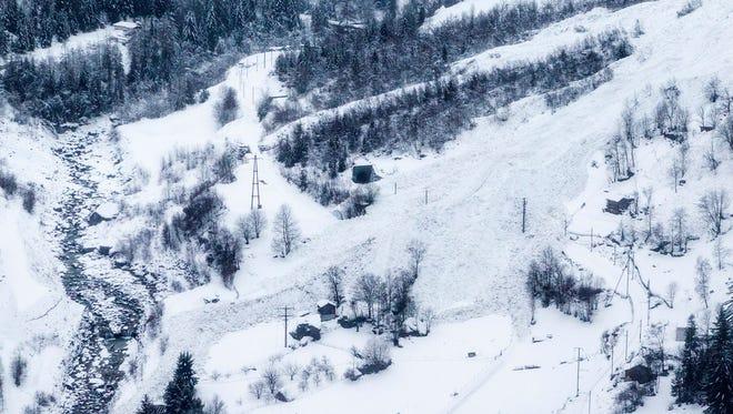 An avalanche crosses the railway track on the way towards Zermatt above St. Niklaus, Switzerland, on Jan. 9.