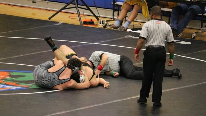 Jensen Beach wrestler Chad Nix (left) pins Olympic Heights' Brandon DiPrima in the second period of the 220-pound match to clinch the Falcons' Class 2A state semifinal win Friday, Jan. 19, 2018, at Osceola High School in Kissimmee. Jensen Beach will meet undefeated Riverdale in a state semifinal dual Saturday.