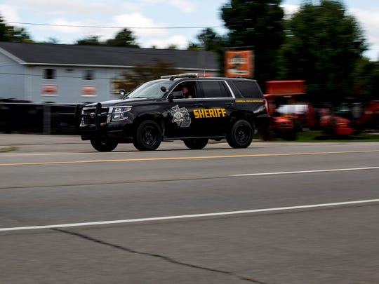 A St. Clair County Sheriff's Deputy pursues a distracted driver Wednesday, September 14, 2016 on 24th Avenue near Keewahdin Road in Fort Gratiot.
