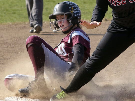 Cami Stigler of Menomonee Falls slides safely into