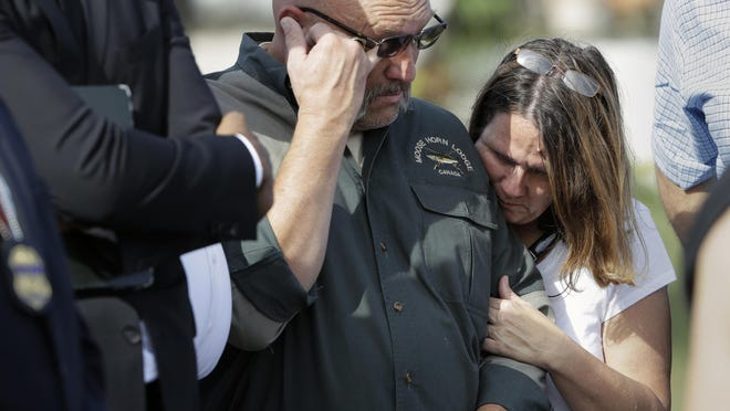 Pastor Frank Pomeroy and his wife Sherri join a news conference near the First Baptist Church of Sutherland Springs Monday. The Pomeroys' daughter, Annabelle, 14, was killed in the shooting.