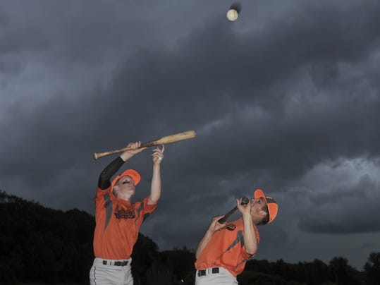 "Northeastern players Jonah Latshaw, left, and Tom Skehan play ""Keep It Up"" with teammates during a delay in their Legion baseball game with Dallastown in Spry Monday, June 8, 2015. The game was cancelled when thunderstorms moved in. Bill Kalina"