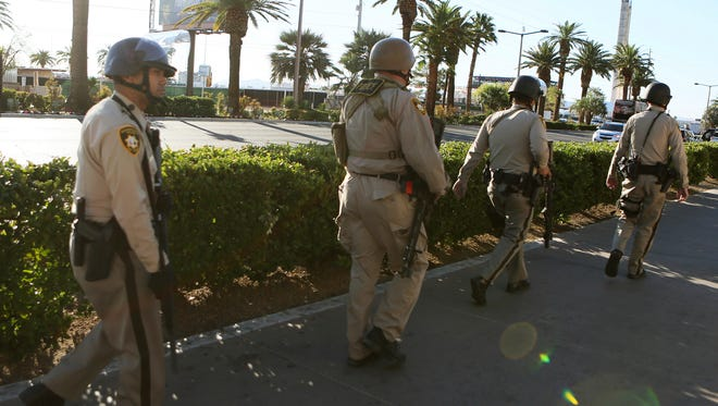 Law enforcement walk on the Las Vegas Strip near Mandalay Bay hotel-casino on Oct. 2 in Las Vegas. A mass shooting occurred late night Sunday at a music festival on the Las Vegas Strip. In West York, the police chief thought the shooting was another example of why police need more protection. Borough council approved the purchases of 13 ballistic helmets.