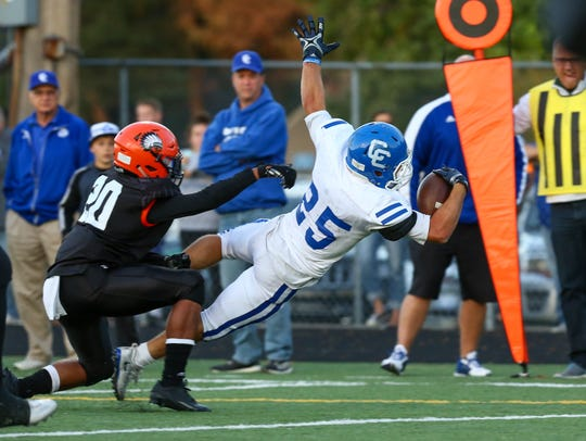 Senior Nicholas Capatina lunges into the end zone for