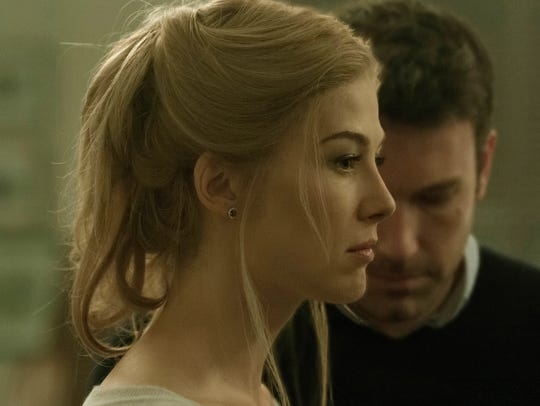 Amy (Rosamund Pike) may not be who she seems in  'Gone