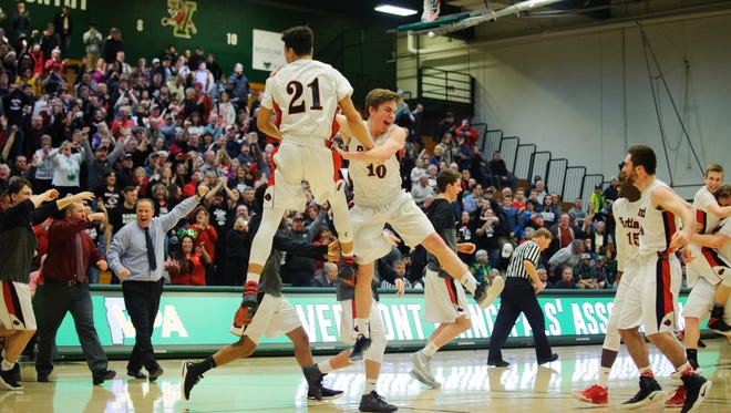 Rutland players celebrate the final horn sounding on their 45-39 win over Mount Mansfield in the Division I boys basketball state championship game at Patrick Gym on Saturday.