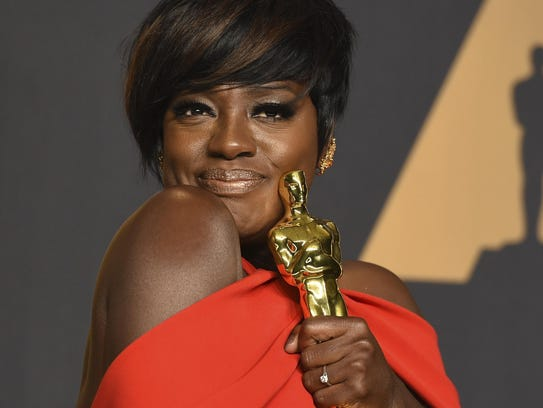 Viola Davis poses in the press room with her Oscars