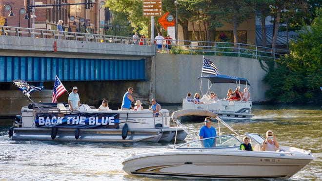 Law enforcement supporters float down the Rock River on Friday during a Boat for the Blue rally in downtown Rockford.