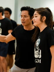 Artistic Director Jojo Urquico, instructs an actress